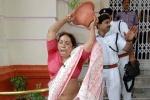 Congress MLC Jyoti Devi breaking flower pots outside the Bihar Assembly